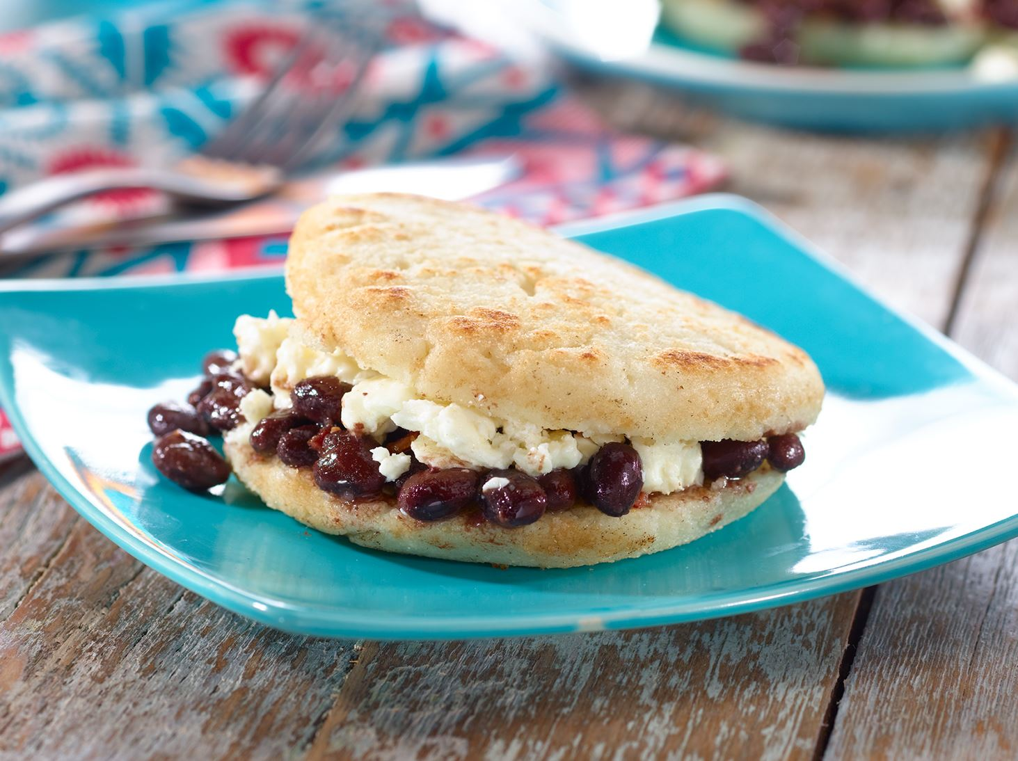 Arepa de Dominó - Venezuelan Corncake filled with Black Beans