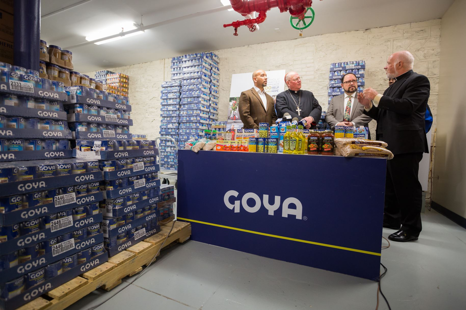 GOYA FOODS CELEBRATES HOLY THURSDAY WITH HIS EMINENCE TIMOTHY CARDINAL DOLAN AND DONATES 300,000 POUNDS OF FOOD TO CATHOLIC CHARITIES' BRONX FOOD DISTRIBUTION CENTER